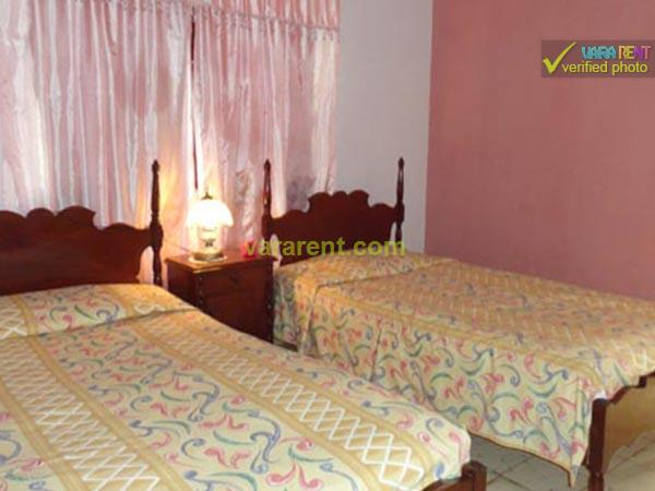Ochi - Bedroom with one full and a single bed