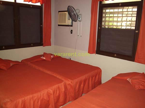 Santa Teresa - Second room with two single and a full bed