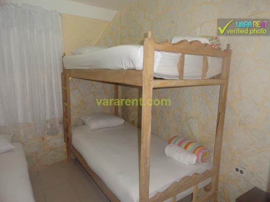 VillaTree - First bedroom with a full and a bunk bed